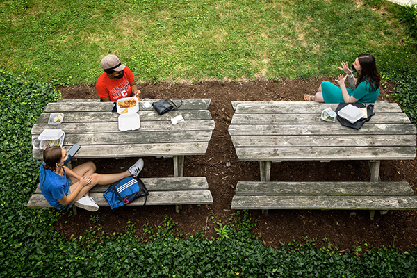 students eat outside