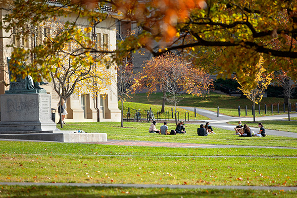 Students seated in a circle on the Arts quad