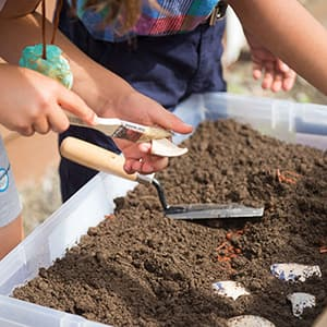 "children dig for ""artifacts"" during archaeology workshop"