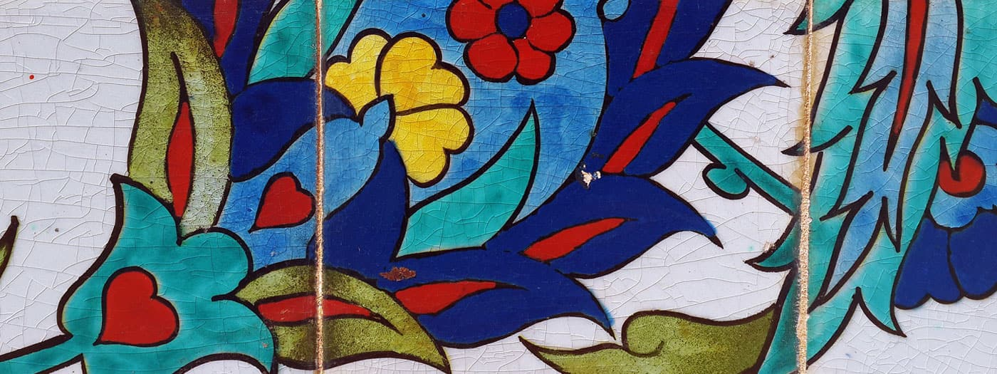 brightly colored, hand painted tiles