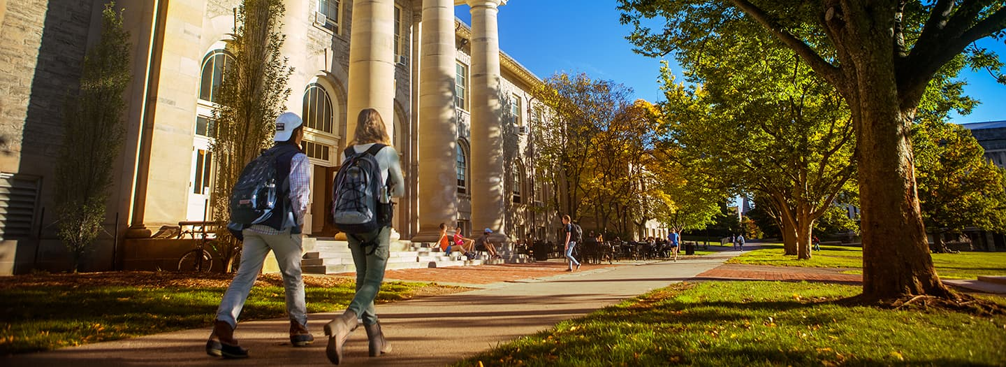 Students walking on the Arts Quad outside Goldwin Smith Hall