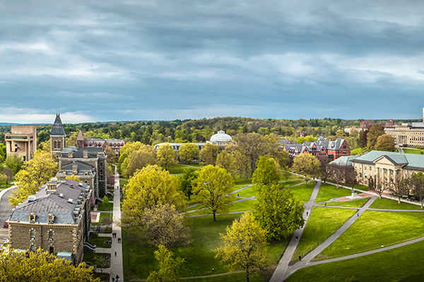 Central campus in spring, with Cayuga Lake, the Arts Quad, Libe Slope, Goldwin Smith Hall
