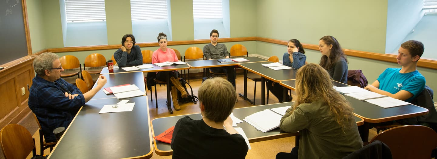Hebrew language instructor, Shalom Shoer, with students in class