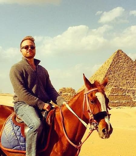 Kyle on a horse in front of the pyramids in Egypt