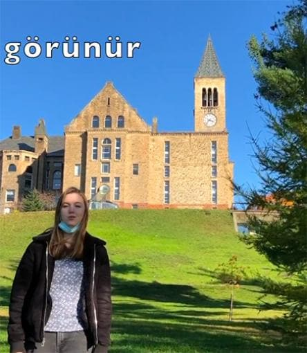 Rebecca Taylor sings Cornell's Alma Mater in Turkish in front of Uris Library