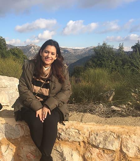 Salma Shitia seated on a wall
