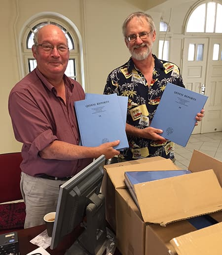 Jeffrey Zorn and Ilan Sharon, two of the co-authors of the recently published report on early G, show off copies of their new volumes.