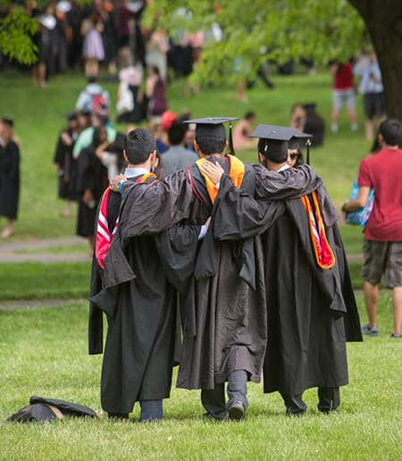 students in caps and gowns at commencement