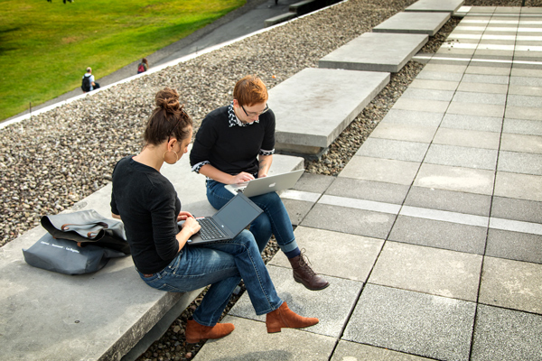 students studying outside olin library
